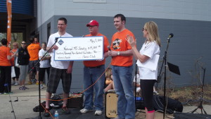 Jim receiving donation