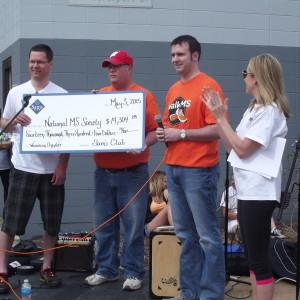 Jim receiving donation